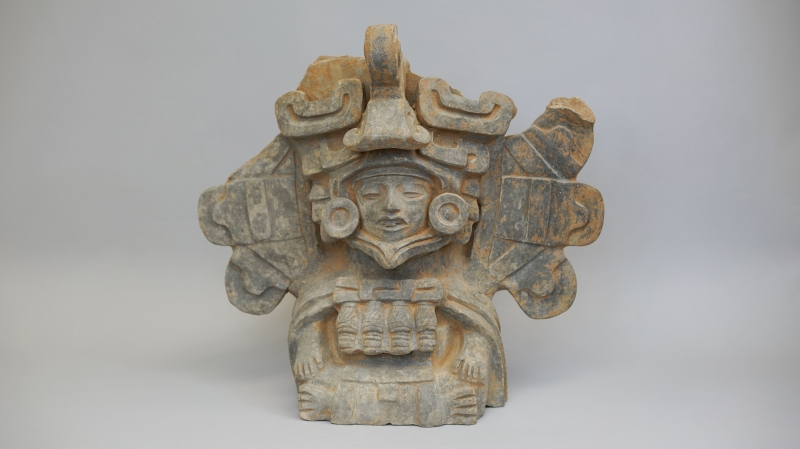 98-67, seated figure urn oma
